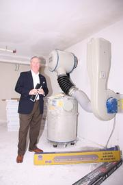 Mayor Buckhorn with a filter for biological and nuclear elements being installed in a bomb shelter at Beit Rishonim Nursing Home, part of the gift from Tampa's Jewish Federation.