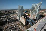Nio Encendio, DJ for Maxima 92.5, rappelling from the 22-story Franklin Exchange building in downtown Tampa.