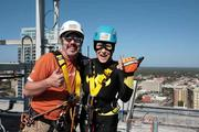 Joanie Cupler mugs with Glenn Segrest, site safety supervisor with Over The Edge USA, before rappelling from the 22-story Franklin Exchange building in downtown Tampa.