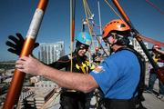 Joanie Cupler gets instruction from volunteer Wm Shrewsbury, with AWS Carpenter Contractors and volunteer with Over The Edge USA, before rappelling from the 22-story Franklin Exchange building in downtown Tampa. Shrewsbury has been rapelling for 33 years.