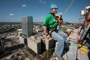 Craig Patrick with Vista Clinical Diagnostics rappelling from the 22-story Franklin Exchange building in downtown Tampa. Patrick is on Heartbeat International's fundraising committee.