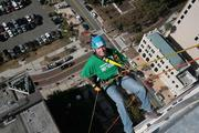 Craig Patrick with Vista Clinical Diagnostics rappelling from the 22-story Franklin Exchange building in downtown Tampa.