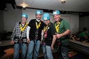 Bill Harris, Randy Borrego and Ed Hartsborn with Swank AV, and John Clayton with National Datacom, get suited up and prepare to head to the roof.