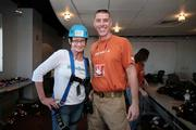 Penny Rogo Bailes, owner of MamaRazzi Foto, with Roy Becker, staging manager for Over The Edge. MamaRazzi was the official event photographer.