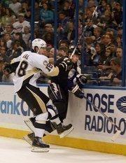 Pittsburgh player James Neal checks a Lightning player.