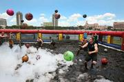 In the foam arena competition, teammates battle in the mud and suds arena.