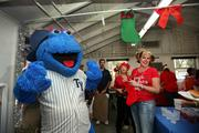 Tampa Yankees mascot, Blue, greeted campers during lunch. Dr. Dave Picca, Tower Diagnostics, Cass Beitzel, Market Power Associates and Peggie Sherry, Faces of Courage founder and chief executive officer help with the visit.