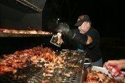 Weekend volunteer Mike Edenfield, Battle & Edenfield PA, barbecued 300 chicken legs for campers, counselors and volunteers.