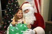 Sissy Ballard, camper, with Santa.