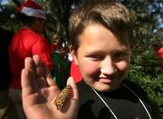 A camper releases his butterfly during the closing ceremony of camp.