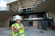 Sara Webster, marketing director for the new Sun Dome management, speaks with a co-worker at what will be the new Gate C entrance.