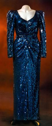 A long, deep green sequined dinner dress, designed by Catherine Walker. Estimated at $225,000/$250,000