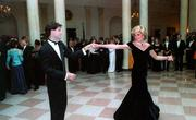 In 1985, Princess Diana wore this dress to a State Dinner at the White House hosted by President & Mrs. Reagan. That evening the Princess danced with Clint Eastwood, Neil Diamond and John Travolta.