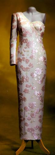 A long evening dress of ivory satin, designed by Catherine Walker. Estimated at $250,000/$300,000