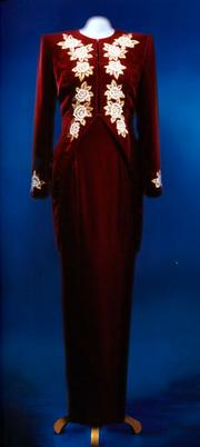 """A long dinner dress and tailcoat of burgundy velvet, designed by Catherine Walker. Diana wore this dress at the film premiere of """"Steel Magnolias"""" in 1990. Estimated at $325,000/$375,000"""