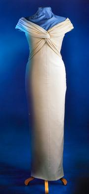 A formal cream-colored silk crepe dinner dress, designed by Catherine Walker. Diana wore this dress for the now-famous photo shoot by Mario Testino in a 1997 issue of Vanity Fair. Estimated at $325,000/$350,000