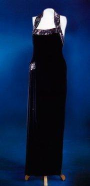 A halter-neck dinner dress in black silk crepe, designed by Catherine Walker. Estimated at $300,000/$350,000