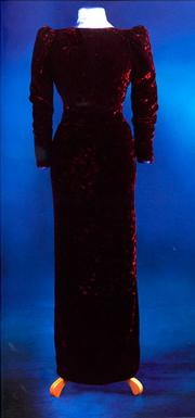 """A burgundy velvet dinner dress, designed by Catherine Walker. Diana wore this dress twice to the ballet and also to the 1985 premier of the film """"Back To The Future."""" Estimated at $225,000/$275,000"""