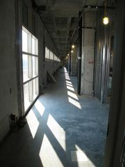 A view down the second floor corridor at Florida Hospital Wesley Chapel. This corridor faces east, along the operating rooms. Key to the design was the Disney concept of front and back stage, said CEO Adams. A series of front and back hallways allow for patients and families to access waiting areas, and staff to be able to move freely with patients and supplies.