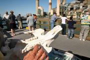 Joanne Johnson, docent for seven years, shows visitors a manatee's upper jaw on the viewing area boardwalk.