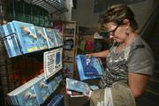 Gayle Brown from Ontario looks at the Winter DVD and puzzle in the gift shop.