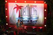 Guests posed for photos in front of a sign welcoming them to the 2012 Republican National Convention celebration.