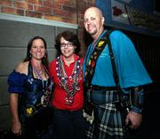 Laura Allen and Jason Hochman from the Gasparilla Krewe of Brigadoon give a Tampa greeting to Kansas delegate, Susan Estes (center) from Wichita.