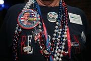 Don Genhart, a delegate from Palm Desert in Southern California, has a chest full of buttons and beads at the welcome party at Tropicana Field on 