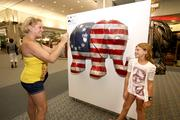 Here's one example of how TBBJ photographer saw some local visitors 'RNCeeing it.' Brytt Mathas and her daughter, Kristin Justice, 10, from St. Petersburg, take photos with her favorite elephant while they were at Tampa International Airport picking up a visitor. Elephants on pillars displayed at TIA are spread out the shopping area as part of the Elephant Herd public art project in conjunction with the Republican National Convention.