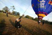 Wind gusts kept the balloon's handlers busy.