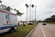 Members of the media line up along Bayshore Boulevard in Tampa outside the Kelleys' home.