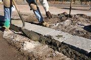 Robert Van Buren, cement worker with PaverSmart.Biz, creates stone walkways throughout the park area in Encore.