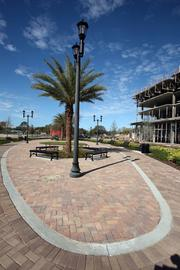 Stone walkways by PaverSmart.Biz make their way through Ella at Encore and the 40-acre site.