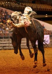 Heath Ford from Slocum, Texas, in the bareback riding event.
