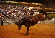 Justin Caylor from Andalusia, Ala., during the saddle bronc riding event.