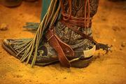 Spurs and dusty boots