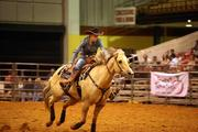 Sherry Cannon from Saint Augustine, Fla., during the barrel racing competition.