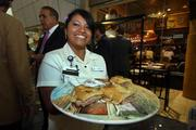 Columbia Restaurant's Jessica Andrade, server, gives the crowd a taste of the Columbia.