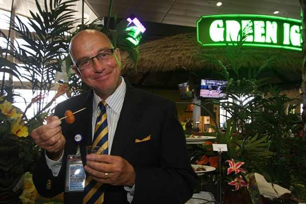 At Tampa International Airport's grand opening of new restaurants and stores, Joseph Lopano, airport CEO, eats a lava martini shot from Green Iguana.