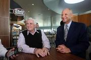Former Miami Dolphins head coach Don Shula, founder of Shula's, and his son, Dave, president of Shula's, speak to the crowd. Tampa International Airport now has Shula's Bar & Grill and Shula Burger take out.
