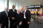 At the Tampa International Airport location of Shula Burger are, from left: Joseph Lopano, airport CEO; Dr. George Tinsley, president and CEO of Tinsley Family Concessions; former Miami Dolphins head coach Don Shula and his son, Dave, president of Shula's; and Tom Fricke, president and CEO of HMSHost Corp.