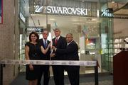 Susan Stackhouse, CEO and owner of Stellar Partners; Jim Fox, director of licensed boutiques; Tom Fricke, president and CEO of HMSHost Corp.; and Bhavesh Patel, director of communications for Tampa International Airport, cut the ribbon at the Swarovski store.