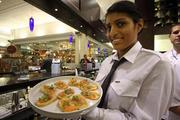 A server at the Tampa International Airport location of First Flight Mise En Place.