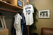 "Rays Manager Joe Maddon's office is filled with jerseys, photos and sports memorabilia. Also known as ""the shrine."""