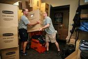 Paul Harker, assistant athletic trainer and Tyler Wall, clubhouse staff, check stock for the training room.