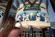 Kari Holemo, a Tampa Bay Rays fan from Houghton Lake, Mich., picked up opening day tickets and stopped to take a photo of Tropicana Field.
