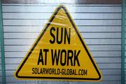 Sign near solar electric panels manufactured by SolarWorld.