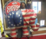 """""""Rasta"""" Geary Taylor of 1 of 1 Customs poses with his work."""