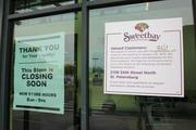 A sign in the door at Midtown Sweetbay in St. Petersburg indicates the store's closing.