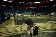 Workers measure pieces of the stage for the Republican National Convention coming next week to the Tampa Bay Times Forum.